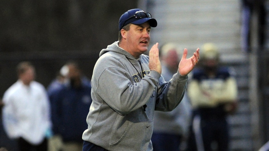 Pittsburgh head coach Paul Chryst, center, claps on the field during the Pittsburgh spring football game on Friday, April 12, 2013, in Bethel Park, Pa. (AP Photo/John Heller)