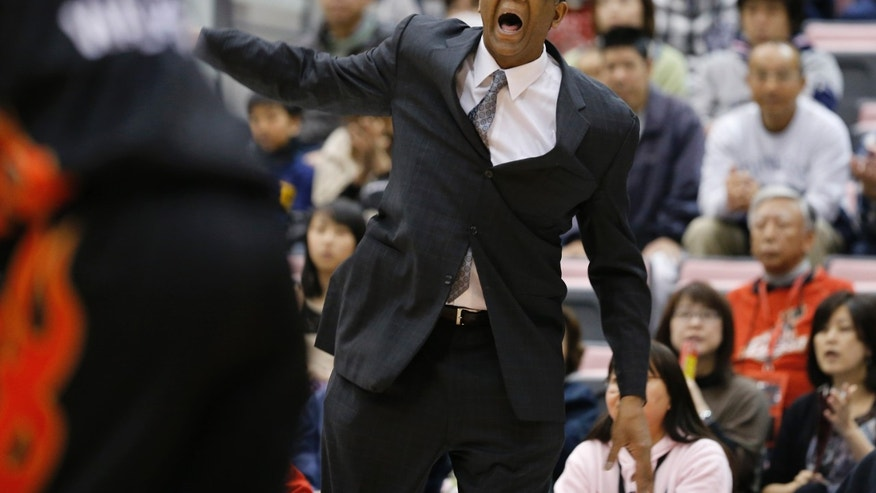 ADVANCE FOR WEEKEND EDITIONS, APRIL 13-14 - In this April 7, 2013 photo, Osaka Evessa coach Bill Cartwright directs players during a BJ league basketball game against Akita Northern Happinets in Kishiwada, Osaka, western Japan. A decade removed from his last head coaching job, former Chicago Bulls player and coach Cartwright is back on the bench imparting the wisdom gained in a basketball life that included career-threatening injuries, confrontations with Michael Jordan and five championship rings. (AP Photo/Shizuo Kambayashi)