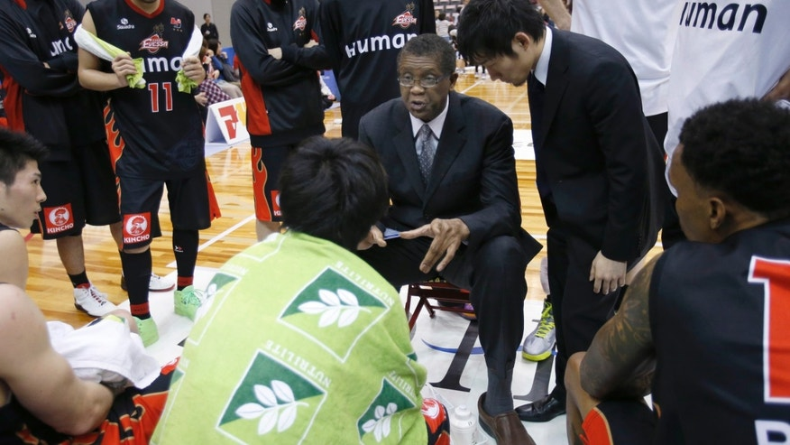 ADVANCE FOR WEEKEND EDITIONS, APRIL 13-14 - In this April 7, 2013 photo, Osaka Evessa coach Bill Cartwright, center, speaks to his team players during a BJ league basketball game against the Akita Northern Happinets in Kishiwada, Osaka, western Japan. A decade removed from his last head coaching job, former Chicago Bulls player and coach Cartwright is back on the bench imparting the wisdom gained in a basketball life that included career-threatening injuries, confrontations with Michael Jordan and five championship rings. (AP Photo/Shizuo Kambayashi)