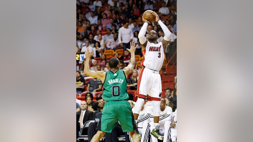 Miami Heat guard Dwyane Wade (3) takes a shot against Boston Celtics guard Avery Bradley (0) during the first half of an NBA basketball game, Friday, April 12, 2013 in Miami. (AP Photo/Wilfredo Lee)
