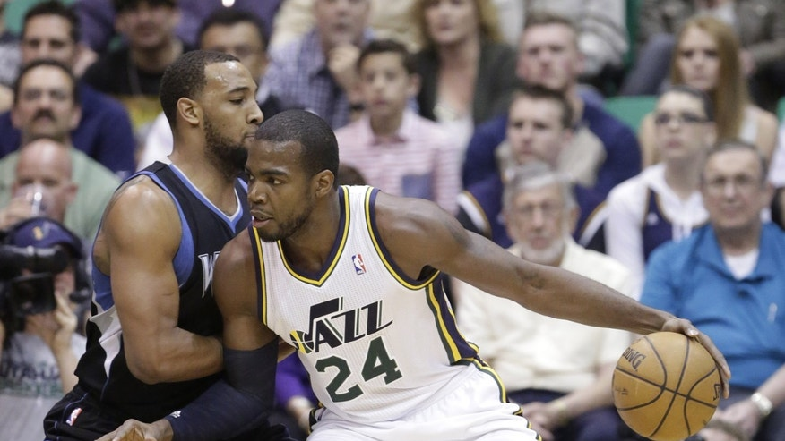 Minnesota Timberwolves' Derrick Williams, left, guards Utah Jazz's Paul Millsap (24) in the first quarter during an NBA basketball game on Friday, April 12, 2013, in Salt Lake City. (AP Photo/Rick Bowmer)