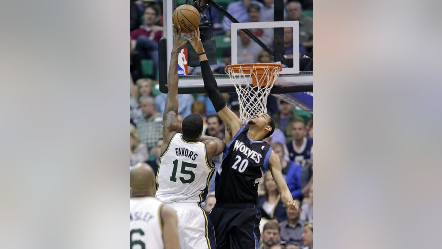 Minnesota Timberwolves' Chris Johnson (20) defends against Utah Jazz's Derrick Favors (15) in the second quarter during an NBA basketball game on Friday, April 12, 2013, in Salt Lake City. (AP Photo/Rick Bowmer)