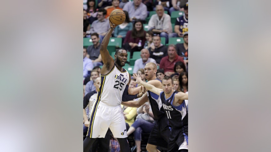 Utah Jazz's Al Jefferson (25) passes the ball as Minnesota Timberwolves' Greg Stiemsma, center, and J.J. Barea (11) defend in the first quarter during an NBA basketball game on Friday, April 12, 2013, in Salt Lake City. (AP Photo/Rick Bowmer)