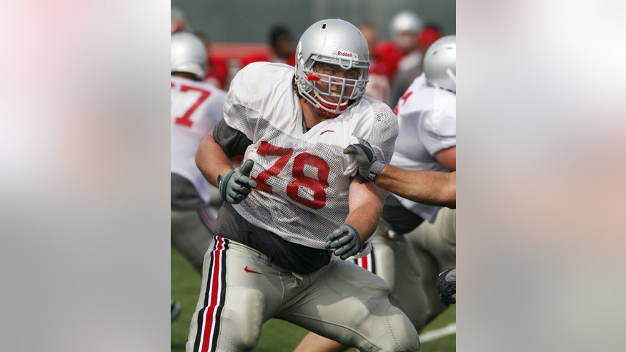 FILE - In this Aug. 10, 2010, file photo, Ohio State offensive lineman Andrew Norwell participates during an NCAA college football practice in Columbus, Ohio. Ohio State is scheduled to conclude its 15 spring practices with an intrasquad scrimmage on Saturday, April 13, 2013, when the Buckeyes bus to Cincinnati to play at Paul Brown Stadium. The team has been split into two squads by coach Urban Meyer and his staff with quarterbacks Braxton Miller and Kenny Guiton off limits for contact. (AP Photo/Terry Gilliam, File)