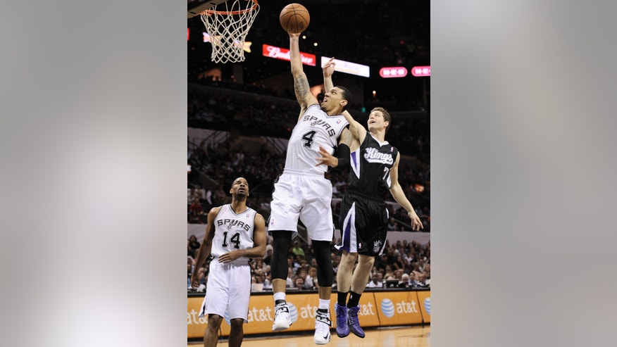 San Antonio Spurs' Danny Green (4) shoots against Sacramento Kings' Jimmer Fredette during the first half of an NBA basketball game, Friday, April 12, 2013, in San Antonio. (AP Photo/Darren Abate)
