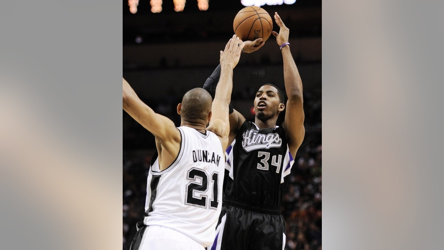 Sacramento Kings' Jason Thompson, right, shoots over San Antonio Spurs' Tim Duncan during the second half of an NBA basketball game on Friday, April 12, 2013, in San Antonio. San Antonio won 108-101. (AP Photo/Darren Abate)