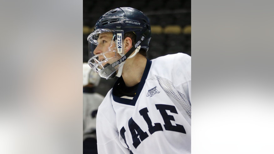 Yale's Andrew Miller skates during NCAA college hockey practice at the Frozen Four on Friday, April 12, 2013, in Pittsburgh. Yale takes on Quinnipiac on the championship game on Saturday. (AP Photo/Keith Srakocic)
