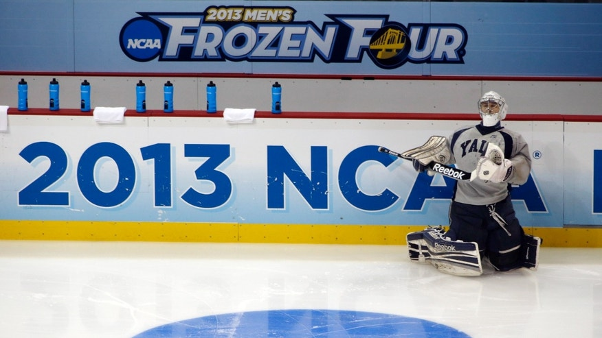 Yale's goalie Nick Maricic stretches during the team's practice session for the Frozen Four NCAA college hockey championship on Friday, April 12, 2013, in Pittsburgh. Yale plays Quinnipiac in the championship game on Saturday. (AP Photo/Keith Srakocic)