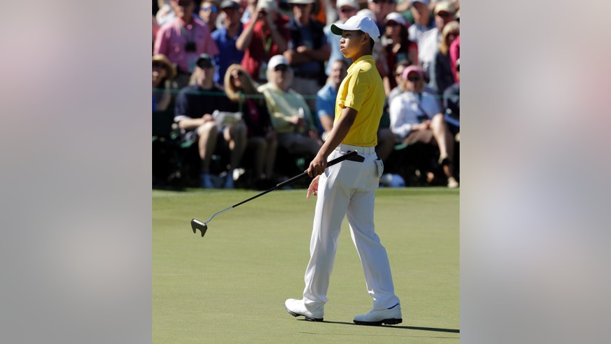 Amateur Guan Tianlang, of China, watches his putt on the second green during the third round of the Masters golf tournament Saturday, April 13, 2013, in Augusta, Ga. (AP Photo/Charlie Riedel)