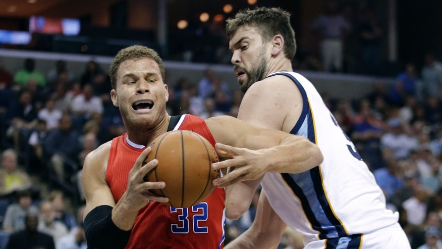 Los Angeles Clippers forward Blake Griffin (32) drives past Memphis Grizzlies center Marc Gasol, of Spain, right, in the first half of an NBA basketball game on Saturday, April 13, 2013, in Memphis, Tenn. (AP Photo/Mark Humphrey)