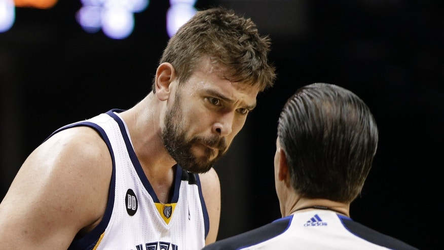 Memphis Grizzlies center Marc Gasol, of Spain, listens as referee Ken Mauer (41) explains his call in the first half of an NBA basketball game against the Los Angeles Clippers on Saturday, April 13, 2013, in Memphis, Tenn. (AP Photo/Mark Humphrey)