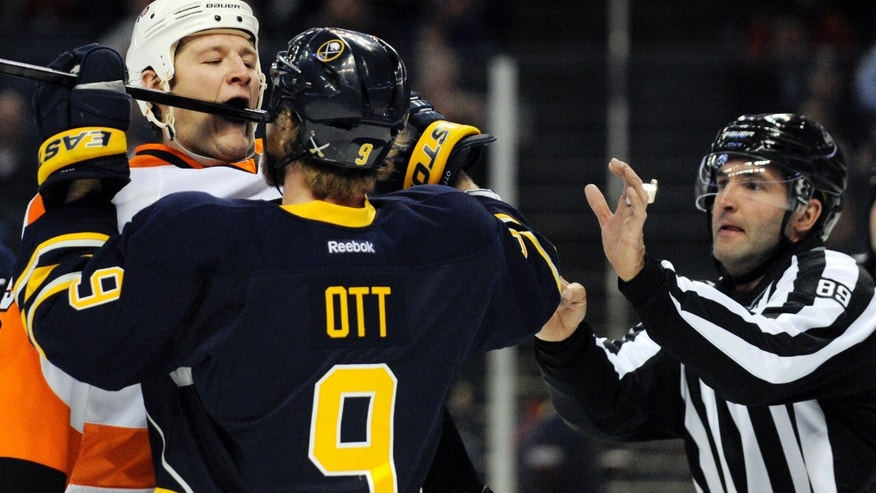 Philadelphia Flyers left winger Jay Rosehill (37) gets a stick shoved into his mouth by Buffalo Sabres center Steve Ott (9) as linesman Steve Miller tries to break up during the first period of an NHL hockey game in Buffalo, N.Y., Saturday, April 13, 2013. (AP Photo/Gary Wiepert)