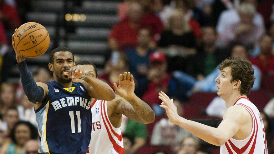 Memphis Grizzlies guard Mike Conley (11) looks to pass against Houston Rockets center Omer Asik (3) during the first half of an NBA basketball game on Friday, April 12,  2013, in Houston. (AP Photo/ Patric Schneider)