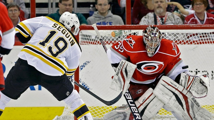 Boston Bruins' Tyler Seguin (19) shoots and scores on Carolina Hurricanes goalie Justin Peters (35) during the second period of an NHL hockey game in Raleigh, N.C., Saturday, April 13, 2013. (AP Photo/Gerry Broome)