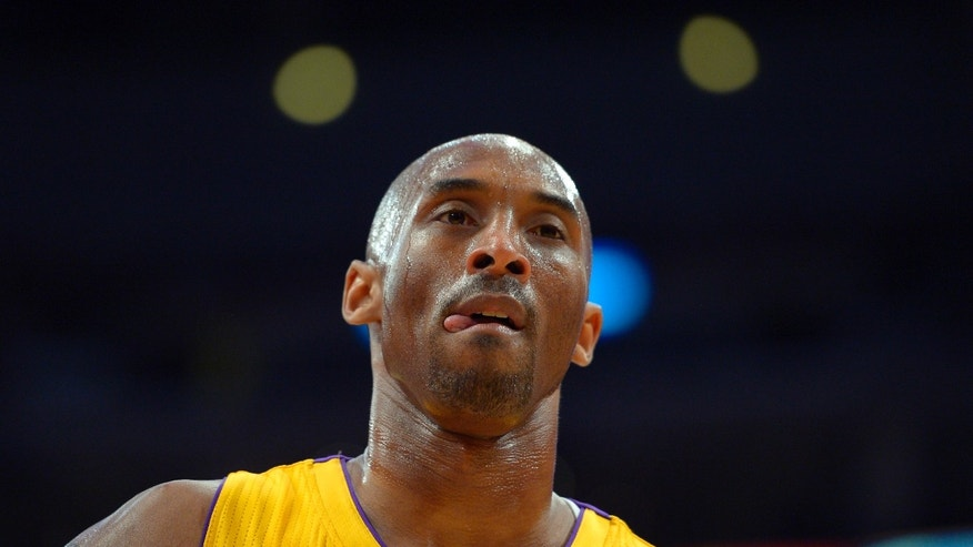 Los Angeles Lakers guard Kobe Bryant looks on during the first half of their NBA basketball game against the Golden State Warriors, Friday, April 12, 2013, in Los Angeles. (AP Photo/Mark J. Terrill)