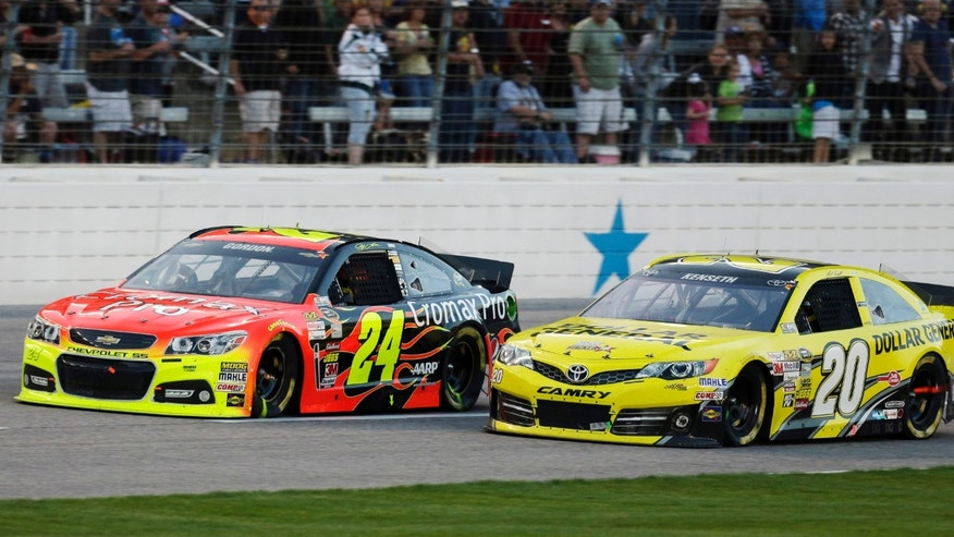 Jeff Gordon (24) passes Matt Kenseth (20) during the NASCAR Sprint Cup series NRA 500 auto race at Texas Motor Speedway, Saturday, April 13, 2013, in Fort Worth, Texas. (AP Photo/Tony Gutierrez)
