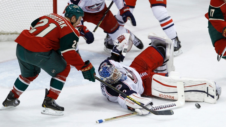 Columbus Blue Jackets goalie Sergei Bobrovsky, of Russia, blocks a shot by Minnesota Wild center Kyle Brodziak (21) during the first period of an NHL hockey game in St. Paul, Minn., Saturday, April 13, 2013. (AP Photo/Ann Heisenfelt)