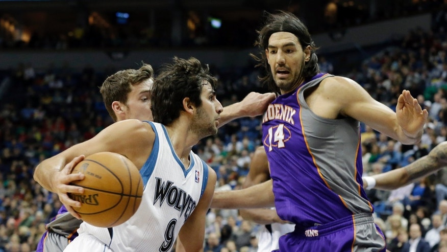 Minnesota Timberwolves' Ricky Rubio, left, of Spain, drives around Phoenix Suns' Luis Scola, of Argentina, in the first quarter of an NBA basketball game on Saturday, April 13, 2013, in Minneapolis. (AP Photo/Jim Mone)