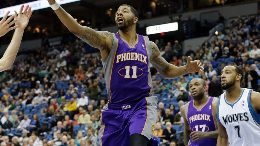 Phoenix Suns' Markieff Morris (11) pulls in a defensive rebound as Minnesota Timberwolves' Derrick Williams, right, looks on in the first quarter of an NBA basketball game on Saturday, April 13, 2013, in Minneapolis. (AP Photo/Jim Mone)
