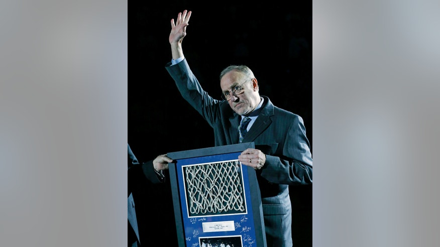 Minnesota Timberwolves head coach Rick Adelman waves to fans after he received a presentation honoring him for recording his 1,000 career win last week prior to an NBA basketball game against the Phoenix Suns, Saturday, April 13, 2013, in Minneapolis. (AP Photo/Jim Mone)