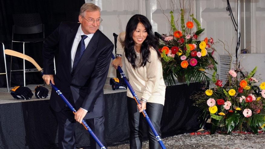 Buffalo Sabres' owner Terry Pegula and his wife, Kim Pegula, pose for cameras during groundbreaking ceremonies at  First Niagara Center before an NHL hockey game against the Philadelphia Flyers in Buffalo, N.Y., Saturday, April 13, 2013. (AP Photo/Gary Wiepert)