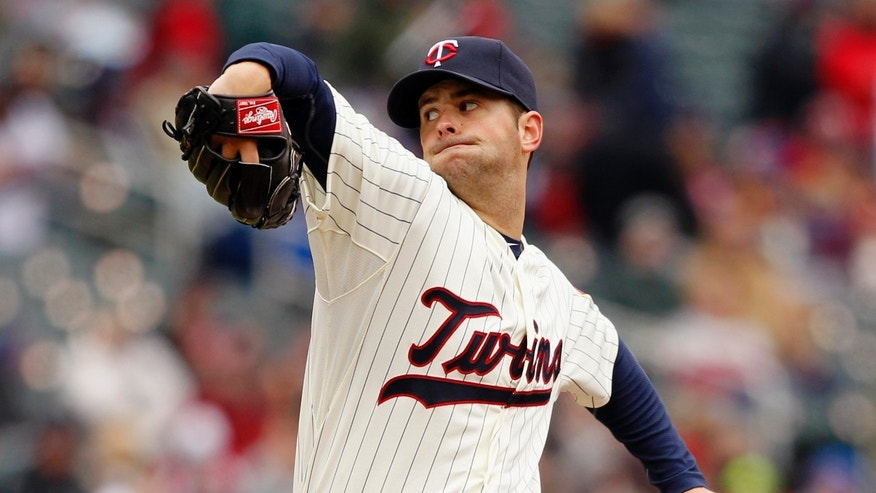 Minnesota Twins starting pitcher Scott Diamond throws against the New York Mets during the first inning of a baseball game Saturday, April 13, 2013, in Minneapolis. (AP Photo/Genevieve Ross)