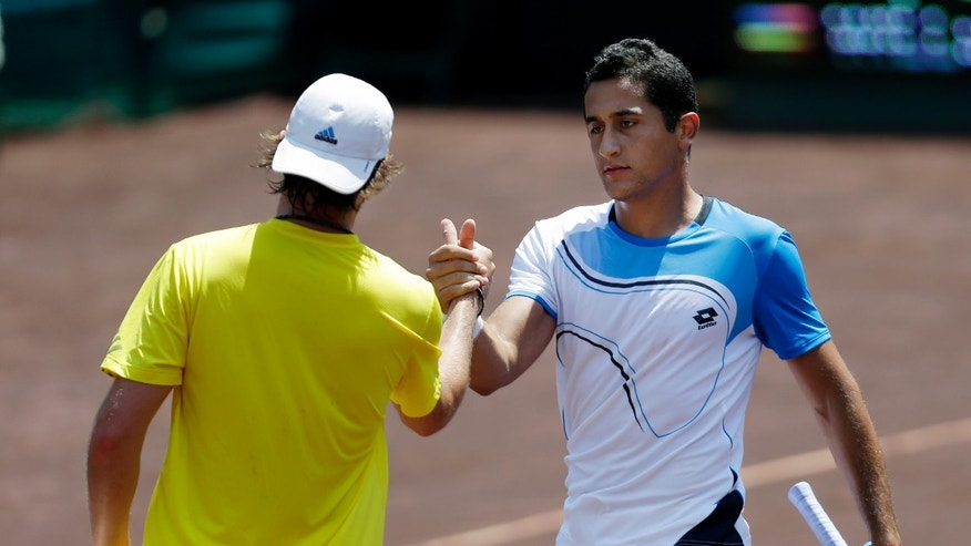 Nicolas Almagro, right, of Spain, shakes hands with Rhyne Williams, left, of the United States, after their semifinal tennis match at the U.S. Men's Clay Court Championship, Saturday, April 13, 2013, in Houston, Texas. Almagro won 6-2, 6-1. (AP Photo/Eric Gay)