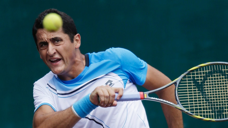 Nicolas Almagro, of Spain, returns a ball against Rhyne Williams, of the United States, during a singles semifinals tennis match at the U.S. Men's Clay Court Championship, Saturday, April 13, 2013, in Houston, Texas. (AP Photo/Eric Gay)