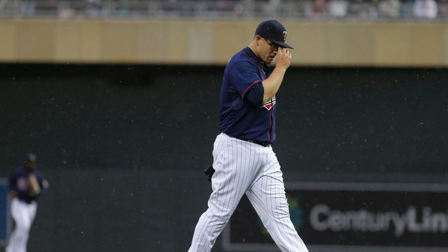 Minnesota Twins pitcher Vance Worley heads to the dugout at the end of the first inning after giving up five runs to the New York Mets in a baseball game on Friday, April 12, 2013, in Minneapolis. Worley was pulled in the second inning. (AP Photo/Jim Mone)