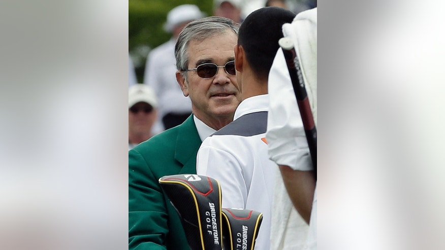 Amateur Guan Tianlang, of China, shakes hands with Augusta National Golf Club Chairman Billy Payne after his fourth round of the Masters golf tournament Sunday, April 14, 2013, in Augusta, Ga. (AP Photo/David J. Phillip)
