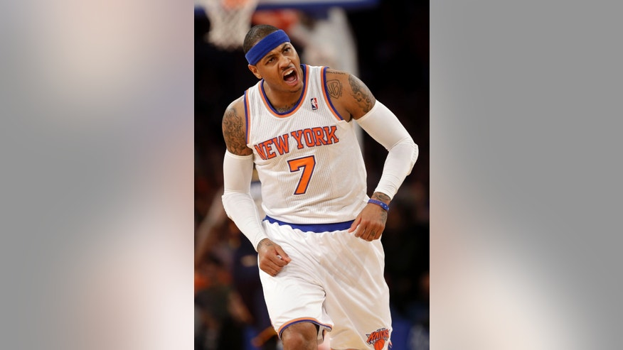 New York Knicks' Carmelo Anthony reacts after scoring during the first half of the NBA basketball game against the Indiana Pacers Sunday April 14, 2013 in New York.  (AP Photo/Seth Wenig)