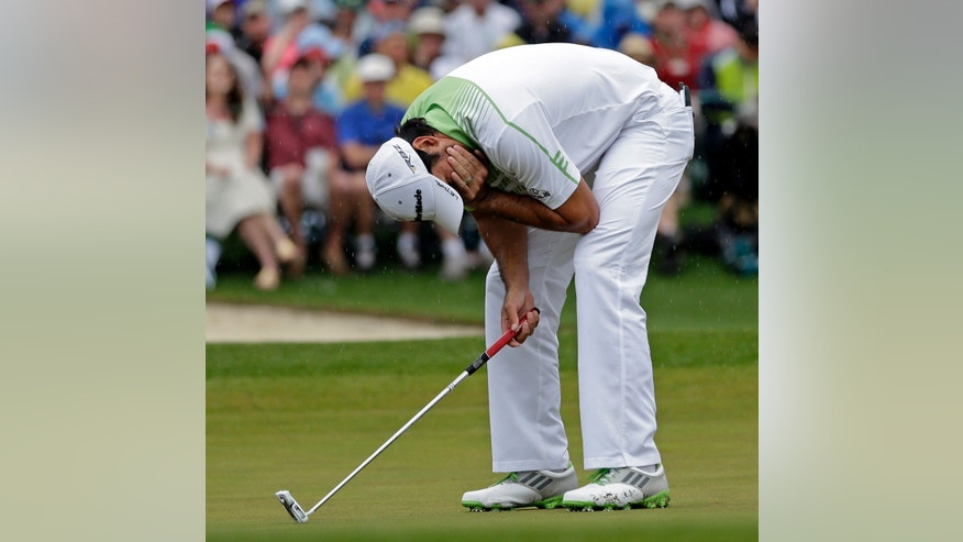 Jason Day, of Australia, reacts after missing a birdie putt on the 18th hole during the fourth round of the Masters golf tournament Sunday, April 14, 2013, in Augusta, Ga. (AP Photo/David J. Phillip)
