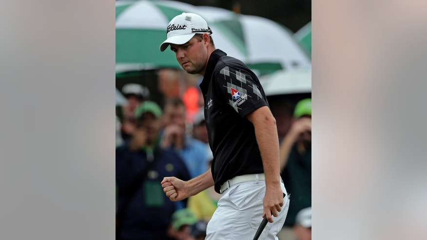 Marc Leishman, of Australia, reacts after a birdie on the ninth hole during the fourth round of the Masters golf tournament Sunday, April 14, 2013, in Augusta, Ga. (AP Photo/Charlie Riedel)
