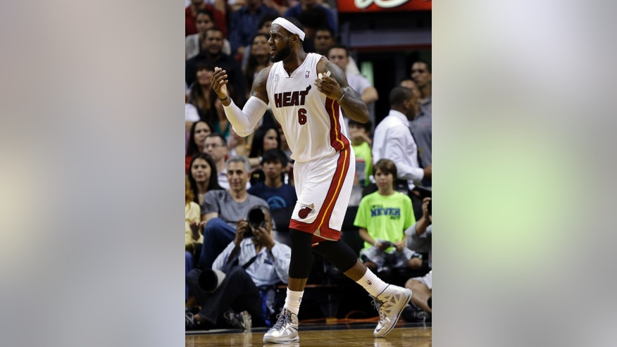 Miami Heat's LeBron James 96) reacts after being called for an offensive foul during the first half of an NBA basketball game against the Chicago Bulls Sunday April 14, 2013, in Miami. (AP Photo/Lynne Sladky)
