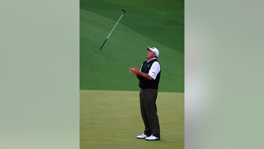 Angel Cabrera tosses his putter in the air after he misses his birdie putt on the second playoff hole on the 10th green to lose the Masters on Saturday, April 13, 2013, in Augusta. Adam Scott then made his birdie putt to win the Masters for his first major victory. (AP Photo/Atlanta Journal Constitution, Curtis Compton)