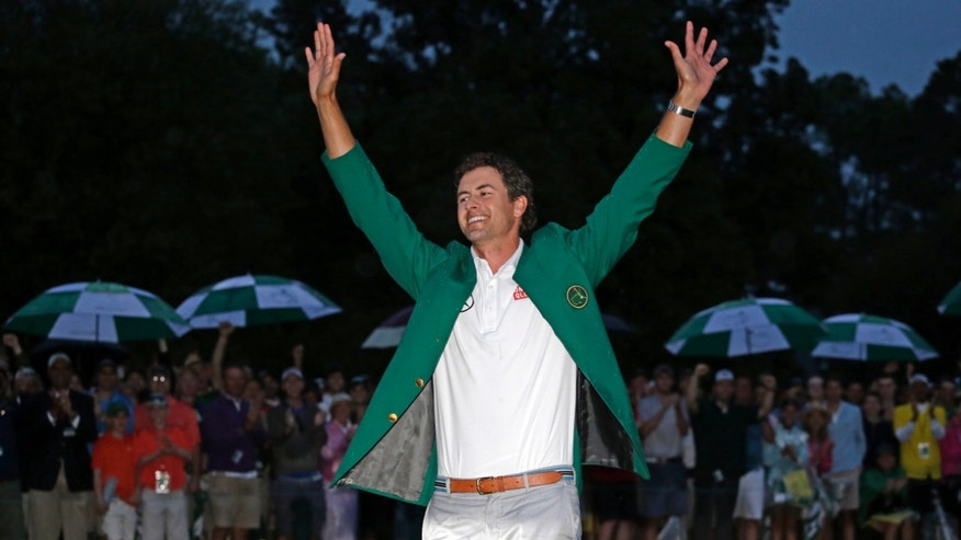April 14, 2013: Adam Scott, of Australia, celebrates with his  green jacket after winning the Masters golf tournament in Augusta, Ga.