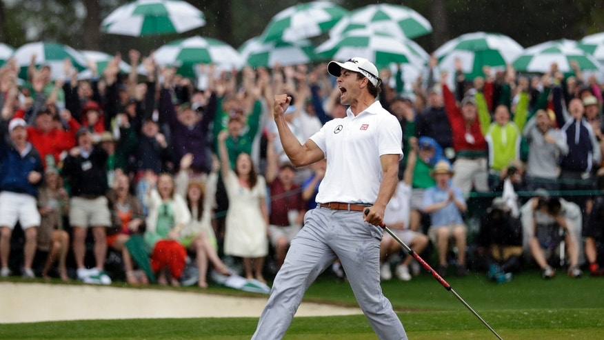 April 14, 2013: Adam Scott, of Australia, celebrates after a birdie putt on the 18th green during the fourth round of the Masters golf tournament in Augusta, Ga.