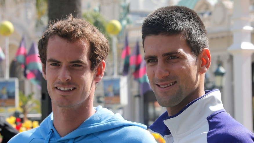 Novak Djokovic of Serbia, right, and Andy Murray of Britain pose for photographers before an exhibition match, in front of the Casino of Monte-Carlo, in Monaco, Saturday, April 13, 2013, during the Monte Carlo Tennis Masters tournament. (AP Photo/Lionel Cironneau)