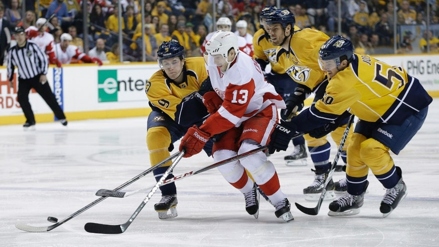 Nashville Predators players Filip Forsberg (9), of Sweden, Roman Josi (59), of Switzerland, and Shea Weber, second from right, try to slow down Detroit Red Wings center Pavel Datsyuk (13), of Russia, in the first period of an NHL hockey game on Sunday, April 14, 2013, in Nashville, Tenn. (AP Photo/Mark Humphrey)