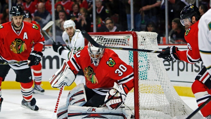 Chicago Blackhawks goalie Ray Emery makes a save during the first period against the Dallas Stars in an NHL hockey game in Chicago, Monday, April 15, 2013. (AP Photo/Charles Cherney)