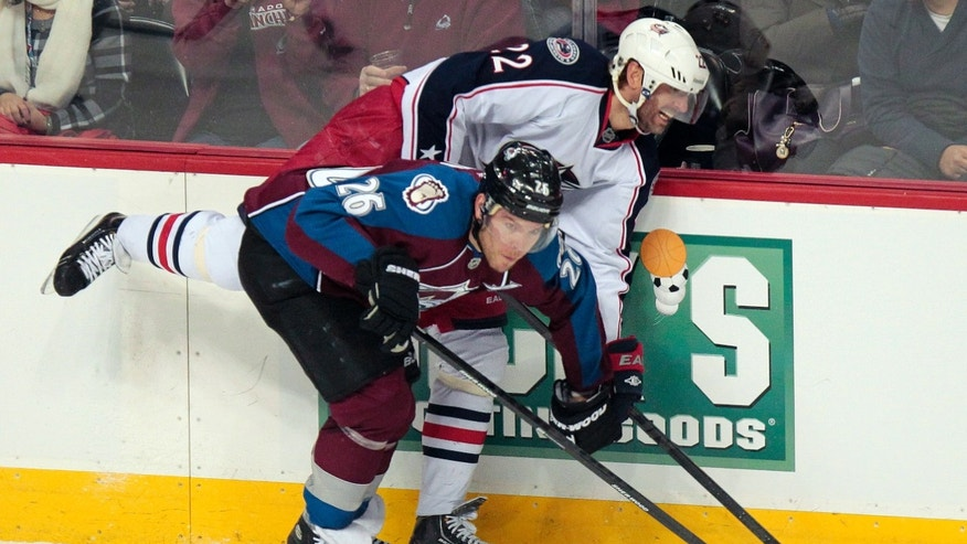 Colorado Avalanche's Paul Stastny (26) checks Columbus Blue Jackets' Vinny Prospal (22) during the first period of an NHL hockey game on Monday, April 15, 2013 in Denver. (AP Photo/Barry Gutierrez)