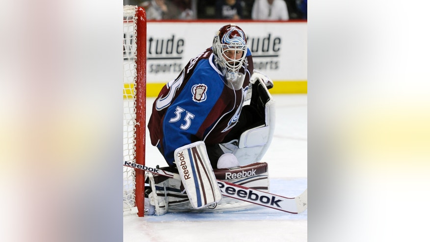 Colorado Avalanche goalie Jean-Sebastien Giguere defends the net in the second period of an NHL hockey game against the Vancouver Canucks on Saturday, April 13, 2013, in Denver. (AP Photo/Chris Schneider)