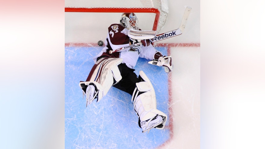 Colorado Avalanche goalie Jean-Sebastien Giguere lays on the ice after being scored on by Los Angeles Kings center Anze Kopitar, right, of Slovenia, during an overtime shootout in their NHL hockey game, Thursday, April 11, 2013, in Los Angeles. The Kings won 3-2 after an overtime shootout. (AP Photo/Mark J. Terrill)