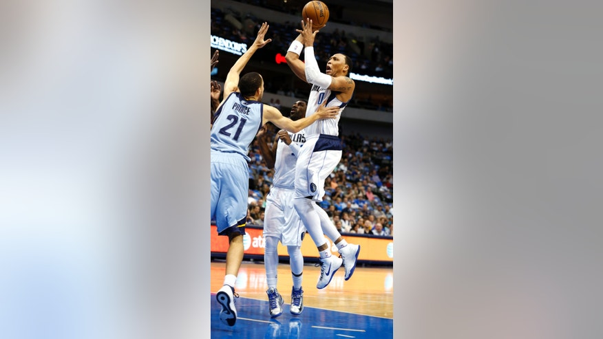 Dallas Mavericks forward Shawn Marion shoots against Memphis Grizzlies forward Tayshaun Prince (21) in the first quarter of an NBA basketball game, Monday, April 15, 2013, in Dallas. (AP Photo/Sharon Ellman)