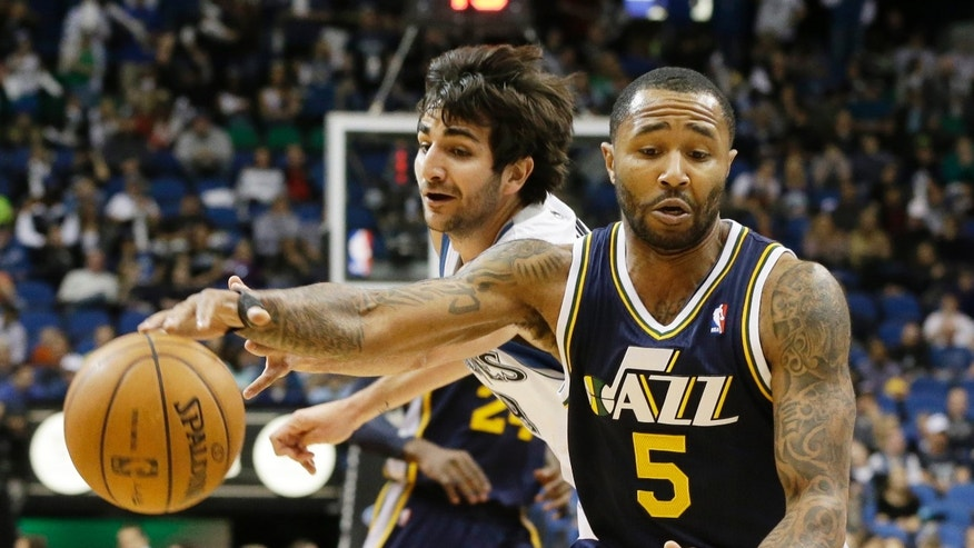 Minnesota Timberwolves' Ricky Rubio, left,  of Spain tries to break up a drive by Utah Jazz's Mo Williams in the first quarter of an NBA basketball game Monday, April 15, 2013 in Minneapolis. (AP Photo/Jim Mone)