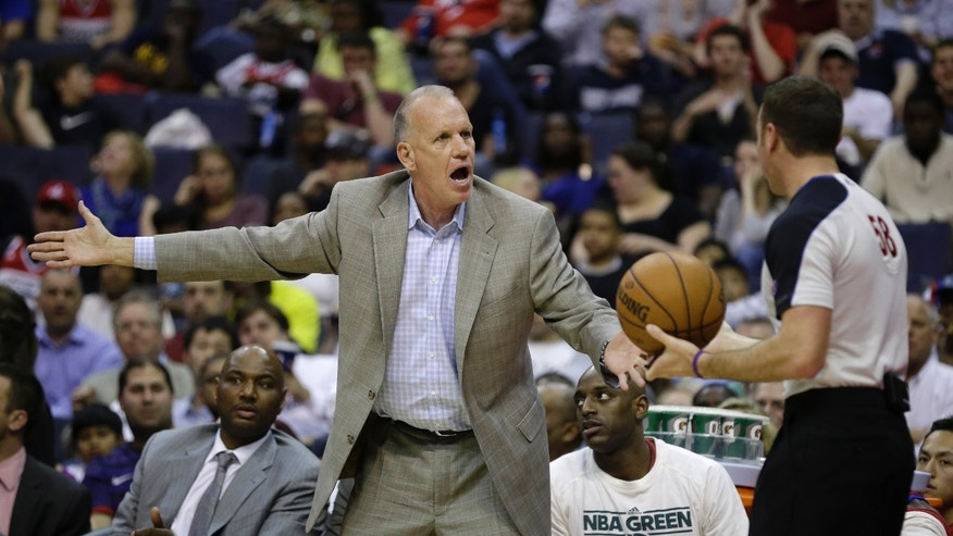 Philadelphia 76ers head coach Doug Collins argues a call during the second half of an NBA basketball game on Friday, April 12, 2013, in Washington. (AP Photo/Evan Vucci)