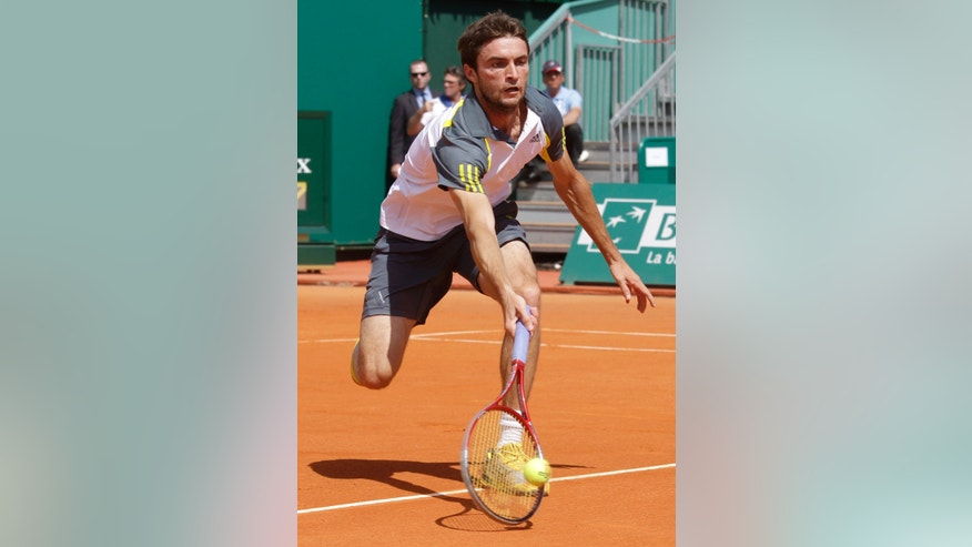 Gilles Simon of France plays a return to Spain's  Roberto Bautista Agut  during their match of the Monte Carlo Tennis Masters tournament in Monaco, Monday, April 15 , 2013. (AP Photo/Lionel Cironneau)