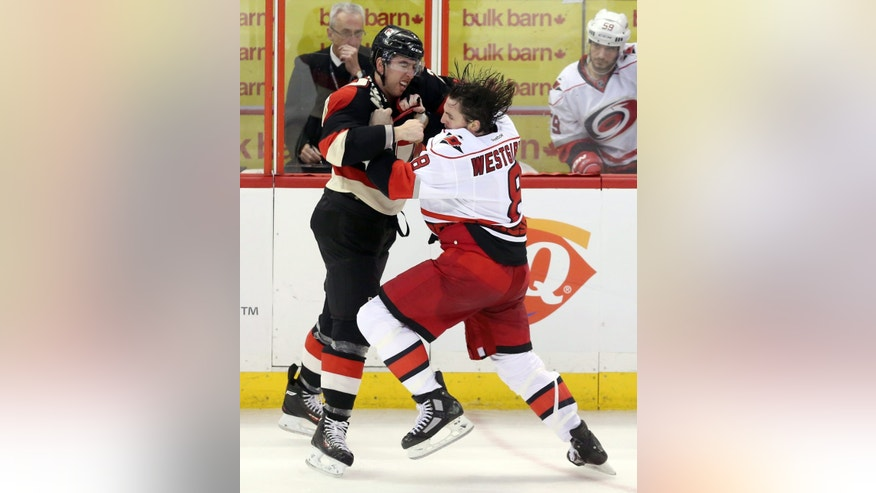 Ottawa Senators' Jared Cowen fights Carolina Hurricanes' Kevin Westgarth (8) during the second period of their NHL hockey game in Ottawa, Ontario, Tuesday, April 16, 2013. (AP Photo/The Canadian Press, Fred Chartrand)