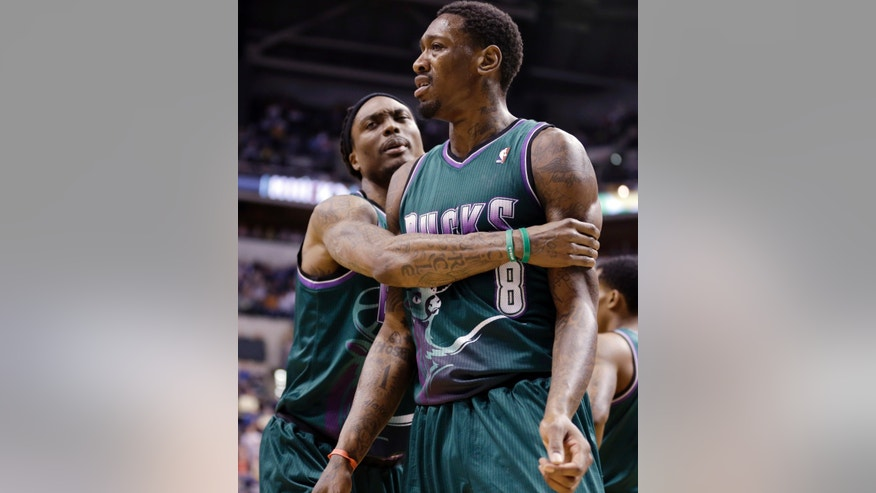 FILE - In this March 22, 2013 file photo, Milwaukee Bucks forward Marquis Daniels, left, holds on to center Larry Sanders after Sanders was ejected in the second half of an NBA basketball game against the Indiana Pacers in Indianapolis. (AP Photo/Michael Conroy)