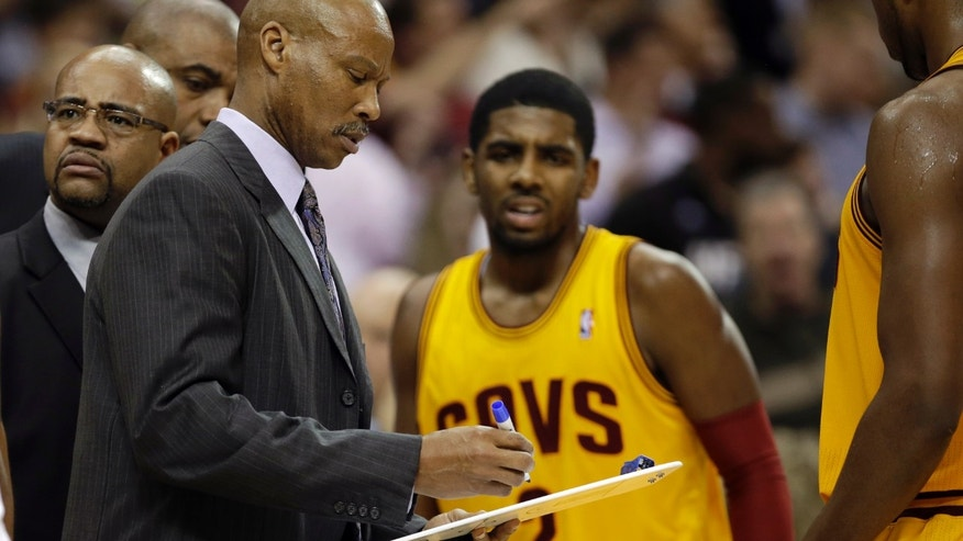 Cleveland Cavaliers head coach Byron Scott diagrams a play as Kyrie Irving (2) watches in the last seconds of the fourth quarter in an NBA basketball game against the Miami Heat Monday, April 15, 2013, in Cleveland. Miami won 96-95. (AP Photo/Mark Duncan)